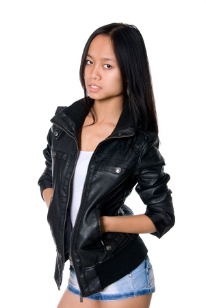Portrait of Asian girl in a leather jacket,isolated on white background photo