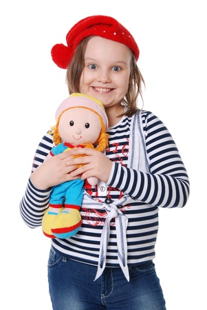 The beautiful little girl with a rag doll isolated on white background photo