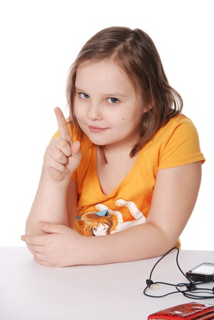 threatens: The little girl threatens with a finger isolated on white background