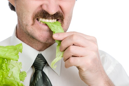 moustached: Man eats sheet of the salad. Isolated on white background