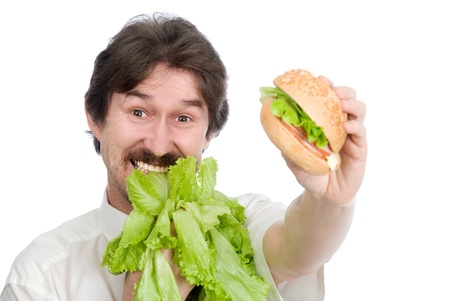 moustached: Man prefers salad instead of hamburger. Isolated on white background
