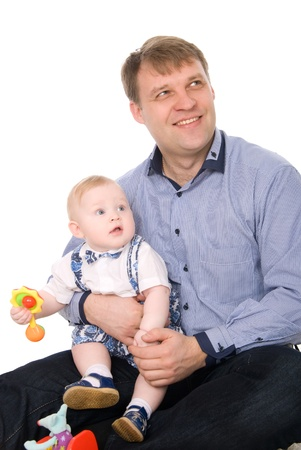 Portrait of a beautiful happy father and the little cute baby.Isolated on white photo