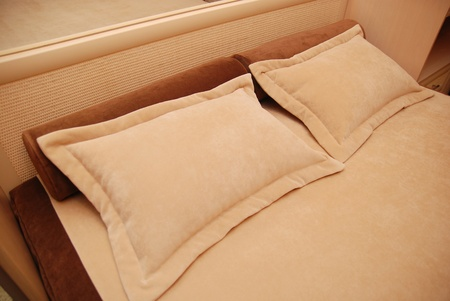 pillows on a bed in a bedroom Stock Photo - 13389636