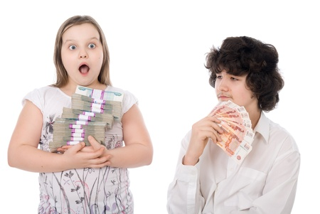 boy and girl with money over white background photo
