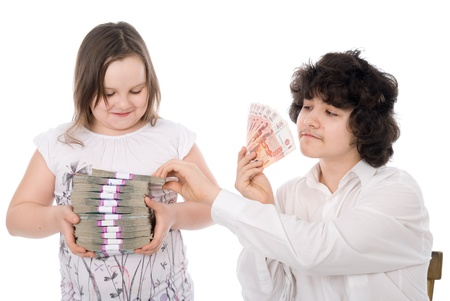 boy takes away a batch of money from girl over white background photo