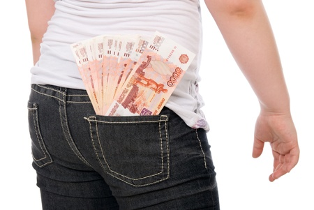 Money sticks out of a hip-pocket over white background photo