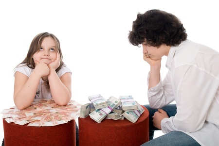 guy with girl consider a lot of money  over white background photo