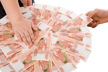 The hands holding  Russian banknotes. photo