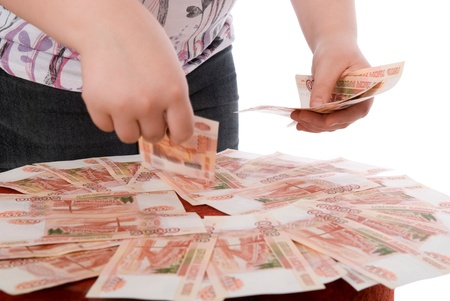 transferable: The teenager gathers money in a hand.Isolated on white Stock Photo