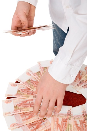 transferable: Person in a white shirt gathers money in a hand.Isolated on white