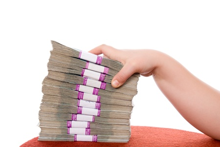 Hand and pile of money  over white background Stock Photo