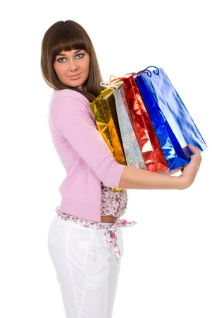Shopping. Beautiful brunette with packages on hands Stock Photo - 13901852