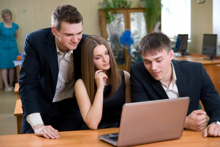 Active young people with laptop with enthusiasm work Stock Photo - 14154961