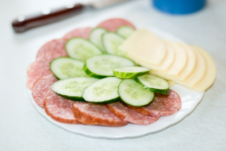 Snack plate with sausage and cheese  photo