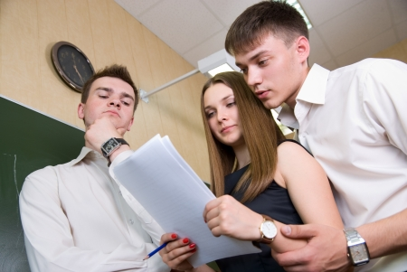 businessmeeting: Document studying by young people at end of working day