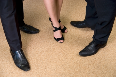 businessman shoes: Feet of business people standing on the floor at office