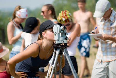geodesy: Student works with a theodolite at practice