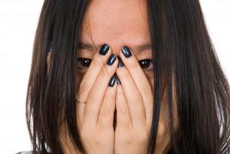 tormented: Close-up portrait girl in despair shuts face with hands.Isolated on white background Stock Photo