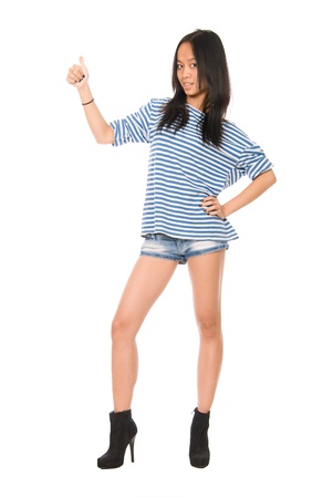 Girl showing thumbs up.Isolated on white background.Asian Caucasian female model. photo