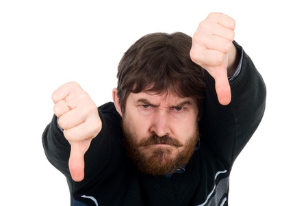 Portrait of the bearded man showing thumbs down. Isolated on a white background