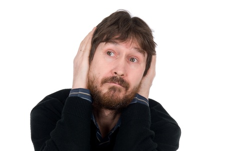 Portrait of thoughtful man with hands on head.Isolated on a white background photo