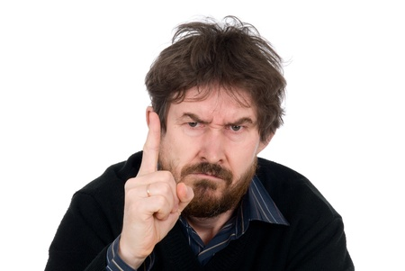 annoyance: Bearded man threatens with a finger.Shaggy head.Isolated on a white background