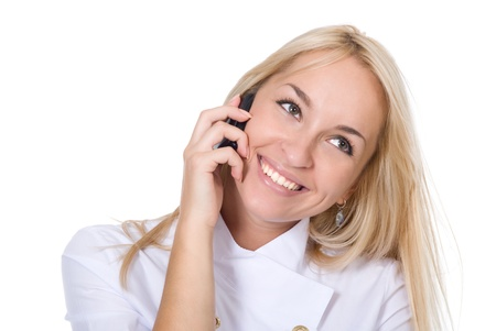 Young smiling beautiful woman-nurse talks by mobile phone, isolated on white background. photo