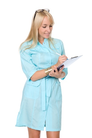 Portrait of the happy young nurse of filling paper on a white background photo