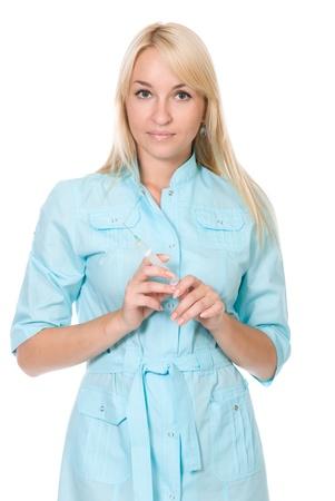 Portrait of female doctor holding a syringe. Isolated over white background photo