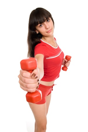 Portrait of a beautiful young girl working out with red dumbbells on white Stock Photo - 15484137