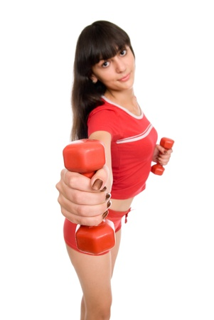 Portrait of a beautiful young girl working out with red dumbbells on white Stock Photo - 15484104