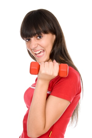 Girl with dumbbell in hand, isolated on white background Stock Photo - 15484243