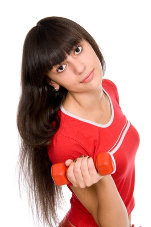 Attractive young girl doing exercises with dumbbells. isolated on white background Stock Photo - 15484274