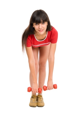 beautiful young woman with dumbbells, isolated against white background Stock Photo - 15484131