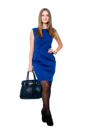 Beautiful young woman with handbag on a white background Standard-Bild