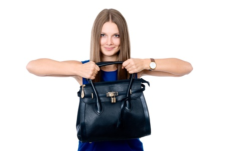 Beautiful woman in a blue dress with a black handbag, isolated on white