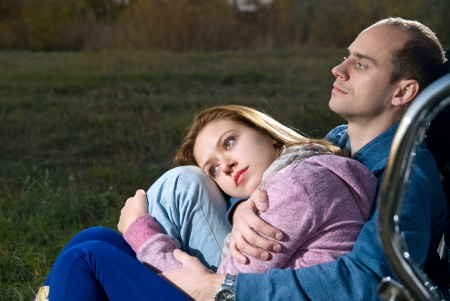 Young couple outdoors at night photo