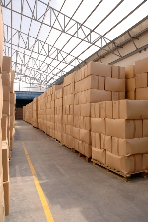 Modern warehouse with cardboard cartons ready to ship photo