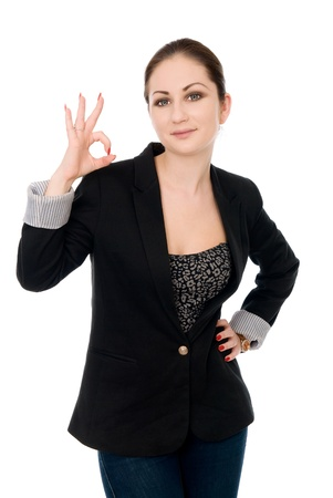 Portrait of attractive businesswoman indicating OK sign isolated on white background photo
