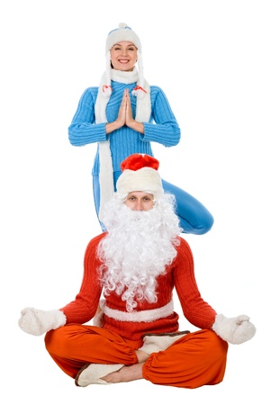 Santa Claus and the Snow Maiden of yoga. Isolated on white Stock Photo