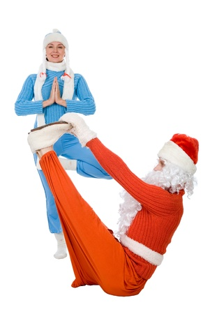 Santa Claus and the Snow Maiden of yoga. Isolated on white photo