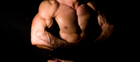 veiny: Close-up build muscle bodybuilder on a dark background Stock Photo