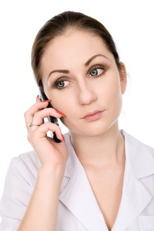 Young female doctor speaking on the phone. Stock Photo - 16559763