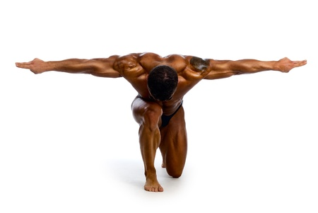 Muscular man with outstretched arms to the side and his head down.isolated on a white background