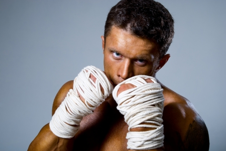 kick-boxer training before fight.Kickboxing or muay thai Stock Photo - 16559123