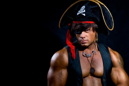 Portrait of a muscular pirate on a black background