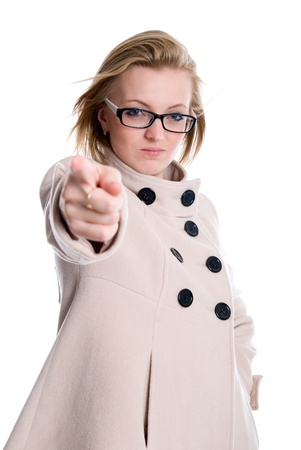 accuses: The girl points a finger directly. Girl in coat accuses. isolated over white background