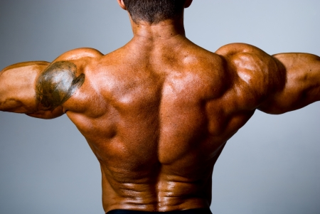 The back muscular man on gray background photo