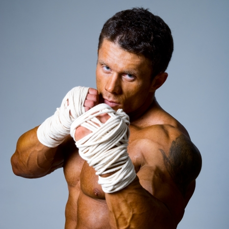 kickboxer: Close-up portrait of a kick-boxer in a fighting stance. Kickboxing or muay thai Stock Photo