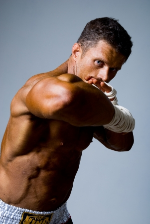 Portrait of a kick boxer in fighting stance. Elbow in the foreground photo